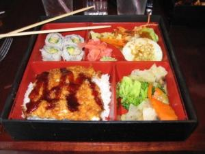 Chicken, Rice, Vegetables, Salad, 4 pieces of Sushi, Ginger, and Wasabi!